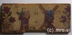 Poslikana panjska končnica. Sveti Jožef z Jezusom in svetim Andrejem.