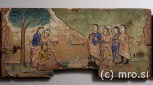Poslikana panjska končnica. Mojzes prikliče vodo iz skale.