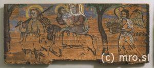 Poslikana panjska končnica. Beg sv. Družine v Egipt.